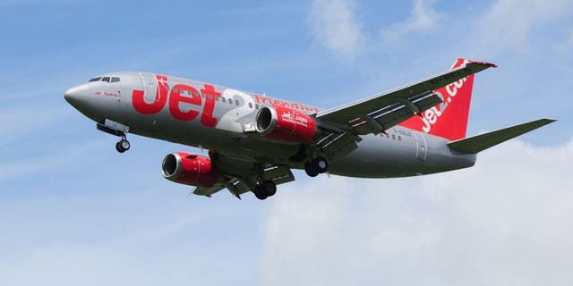 """A woman will spend two years in jail after threatening to """"kill"""" everyone on board a Jet2 flight last summer and attempting to open the emergency exit."""