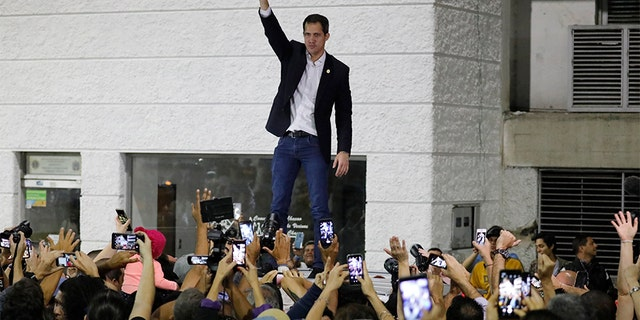 Opposition leader Juan Guaido waves to supporters during a rally at Bolivar Plaza in Chacao, a municipality of Caracas, Venezuela, on Tuesday. (AP)