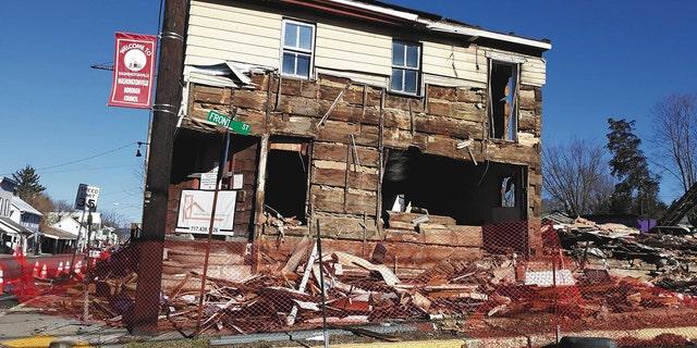 The log cabin was found inside a former bar slated for demolition.