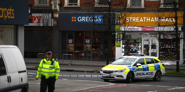 "London police say officers shot a man during a ""terrorism-related"" incident after two people were stabbed."