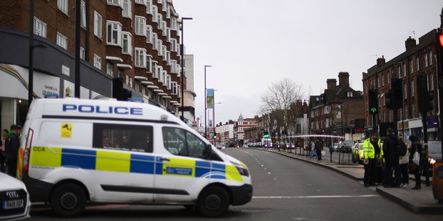 Police at the scene after an incident in Streatham, London, Sunday Feb. 2, 2020.