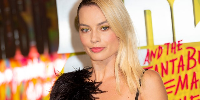 Actress Margot Robbie poses for photographers upon arrival at the world premiere of 'Birds of Prey' in London, Wednesday, Jan 29, 2020.