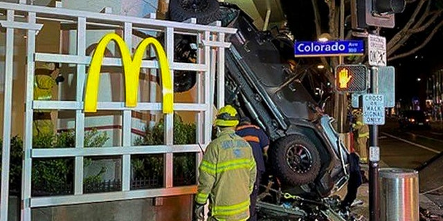 In this early Sunday, Feb. 23, 2020 photo released by the Santa Monica Fire Department shows a vehicle that plunged into the sidewalk in Santa Monica, Calif. (Santa Monica Fire Department via AP)