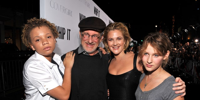 Director Steven Spielberg poses with his daughter, Mikaela (left), actress/director Drew Barrymore and daughter Sasha (right) at the Los Angeles premiere of 'Whip It' at the Grauman's Chinese Theatre in 2009.