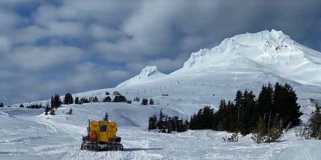 A snowcat carries search and rescue crews up Mount Hood on Feb. 25.