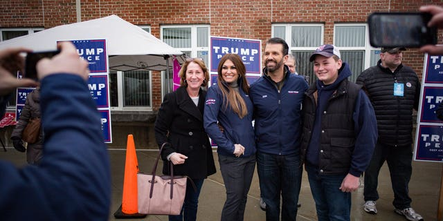 This is a photo of Nate Campbell, right, with Donald Trump Jr., Kimberly Guilfoyle, and his mother Cathy Campbell, left, at Winham High School in New Hampshire before the alleged assault.