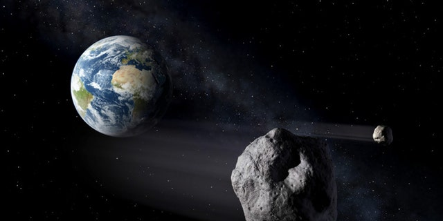 File photo: Artistic impression of two near-earth objects. (ESA / P. Carril)