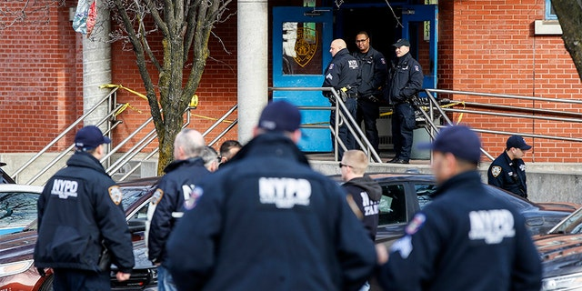 New York City police officers work the scene of a police-involved shooting outside the 41st precinct on Sunday. (AP)