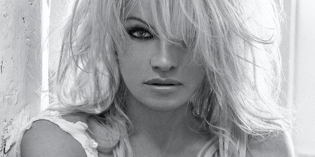 Pamela Anderson is slamming her ex-husband's claims he paid her $200G debt.