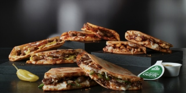 "The panini-adjacent offering comes in four pizza-like flavors, which all use the same ""hand-stretch, oven-baked"" bread."