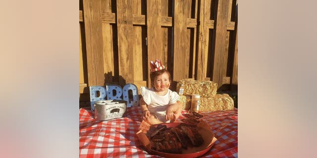 Paul and his wife Denise planned the special barbecue-themed birthday photo shoot, feeling it was more representative of their family than a traditional smash cake.
