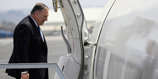 U.S. Secretary of State Mike Pompeo enters the plane before departing from the Addis Ababa Bole international Airport in Addis Ababa, Ethiopia, on Wednesday. (AP)