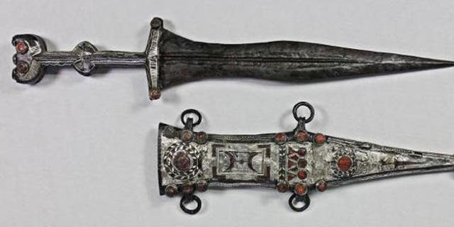 The restorer was able to remove the dagger from its sheath.