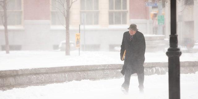 A man walks through blowing snow during blizzard in Buffalo, New York, U.S., Feb. 27. REUTERS/Lindsay DeDario