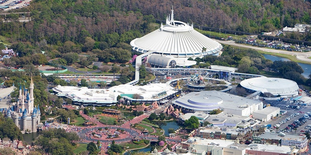 Aerial view of Walt Disney World with Cinderella's castle (left), Space Mountain & Tomorrowland (top-center), Main Street, U.S.A. (right-center) and Monorail System (right).
