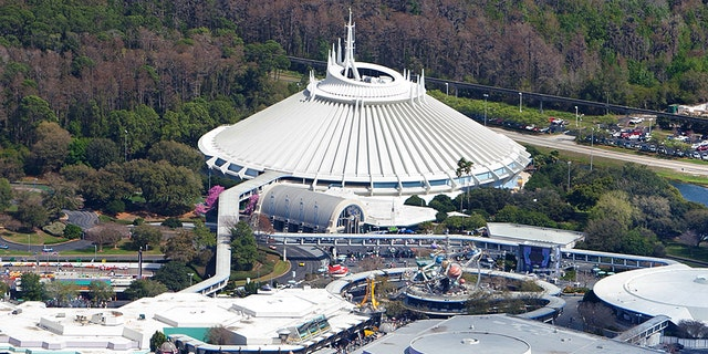 The plaintiff alleges that she was entering the Space Mountain ride, pictured top-center, when an unnamed Disney worker closed a gate on her.