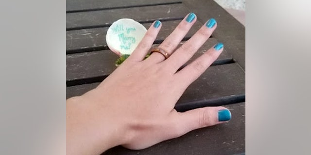 Thoughtfully, Studenic had sea glass saved from their first Bonaire trip crushed and embedded into the engagement ring.