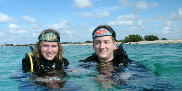 Scuba diving is a shared passion for Ethan Studenic and Morgan Whittaker, pictured, who got engaged while scuba diving in the Caribbean.