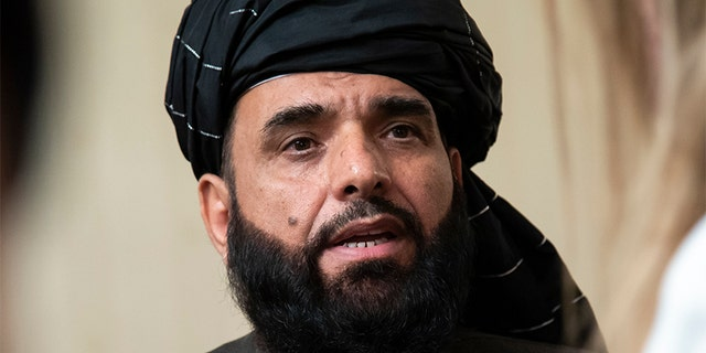 """In this 2019 file photo, Suhail Shaheen, spokesman for the Taliban's political office in Doha, speaks to the media in Moscow, Russia. The countdown to the signing of a peace agreement between the Taliban and the United States to eventually end the 18 years of war in Afghanistan will begin on Friday night, when the seven-day """"reduction of violence"""" promised by the Taliban will go into effect, a senior U.S. State Department official said. (AP)"""