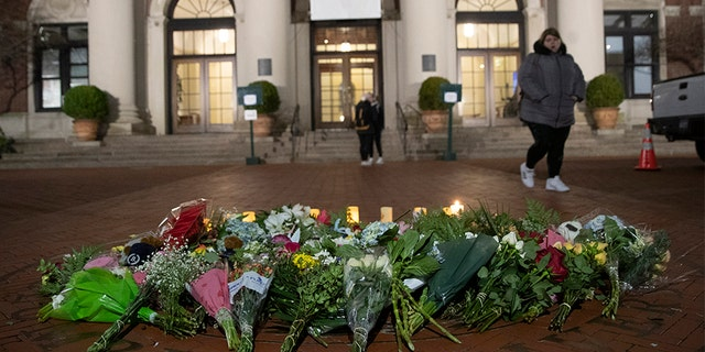 In this December 2019 photo, a woman walks past a make-shift memorial for Tessa Majors inside the Barnard College campus in New York. (AP)