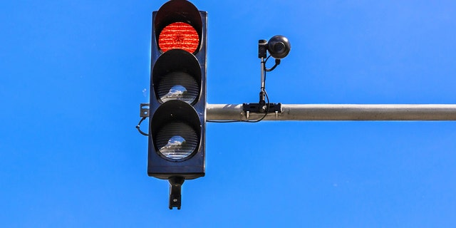 STOCK - A traffic light and a surveillance camera. Washington, D.C. has used parking tickets, speed cameras and more to rack up over $1 billion in revenue from drivers over a three year period, according to WJLA. (iStock)