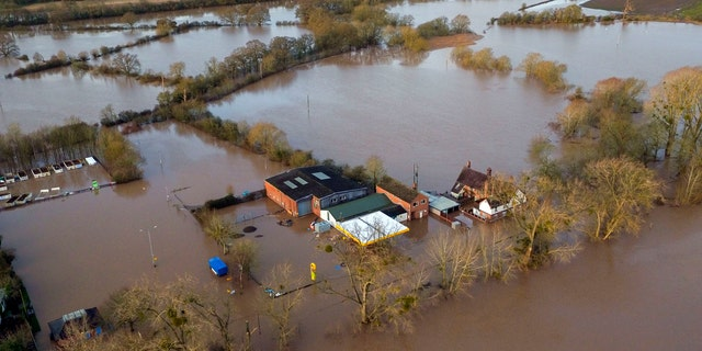 Flood water surrounds Upton upon Severn, England, Tuesday Feb. 18, 2020.