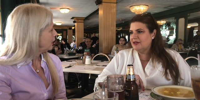 """Maria Fernandez Gomez, pictured on the right, says her father was anti-revolutionary and a political prisoner in Cuba, before they fled the country. She was one of the few who took """"Freedom Flights"""" to Spain. The two are pictured having lunch at Versailles, a popular Cuban restaurant in Little Havana."""
