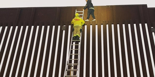 A man was rescued from atop the U.S.-Mexico border wall near San Diego on Tuesday.