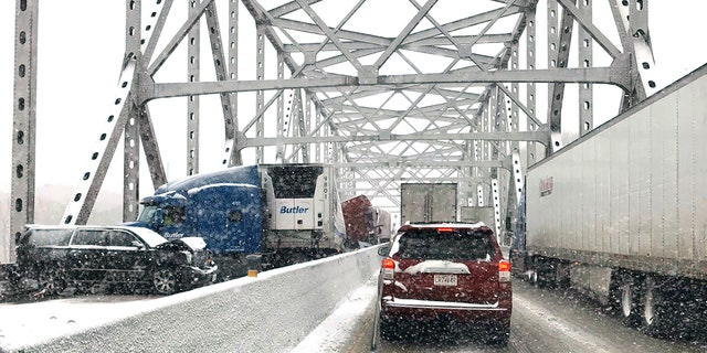 In this photo released by the Missouri State Highway Patrol, a multi-vehicle pileup on Interstate 70 on the bridge that spans the Missouri River near Rocheport, Mo., is shown during a winter storm, Wednesday, Feb. 5, 2020.