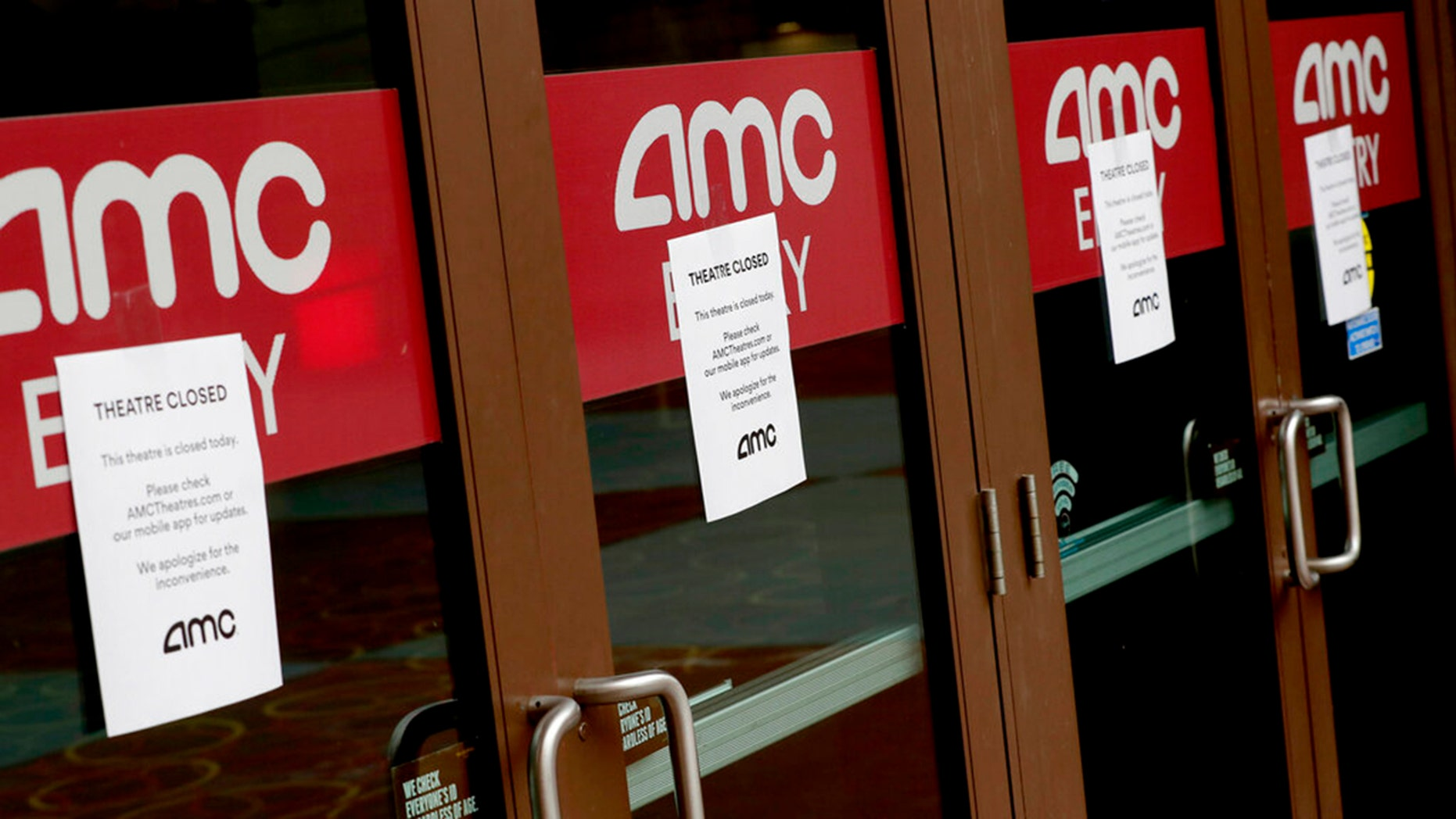 A movie theatre is closed Wednesday, March 18, 2020, in Phoenix due to the coronavirus. Experts say the film industry may have more trouble bounding back than previously thought.  (AP Photo/Matt York)