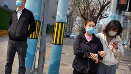 Who are the key players in China's coronavirus propaganda war with US?