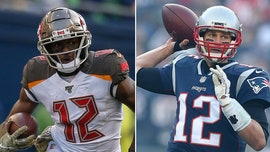 Buccaneers quarterback Tom Brady gets No. 12 jersey from wide receiver Chris Godwin