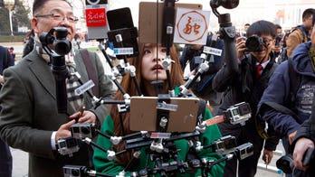 China takes aim at 4 US media companies, demanding staff, business info