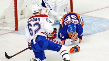 Islanders defenseman Johnny Boychuk takes skate to the face