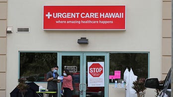 Hawaii鈥檚 governor asks tourists to stay away for 30 days amid outbreak