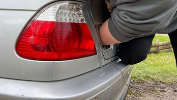 Firefighters rescue man with hand stuck in his car's trunk lid