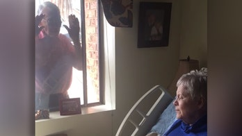 Alabama man serenades wife with Alzheimer's through window amid coronavirus nursing home restrictions