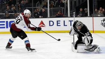 Kings extend win streak to 6, Avs' MacKinnon injured
