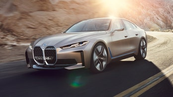 How does the electric BMW Concept i4 compare to the Tesla Model S?