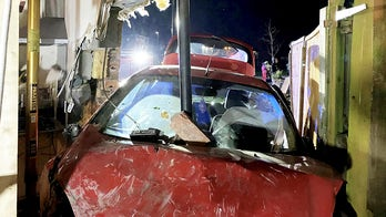 Driver on the run after crashing into home, having car impaled by pipe