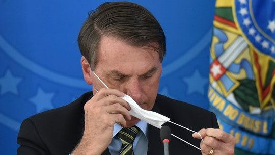 Bolsonaro balks against more coronavirus protections as cases in Brazil near 5,000