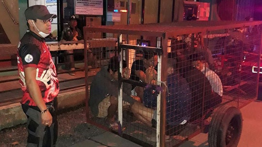 Coronavirus lockdown in Philippines lands official in trouble after violators placed in dog cage