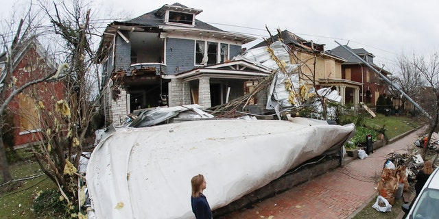 A roof from a nearby business lies in the front yard of a home Wednesday, March 4, 2020, in Nashville, Tenn. Residents and businesses faced a huge cleanup effort after tornadoes hit the state Tuesday, killing 24 people and leaving many others missing.