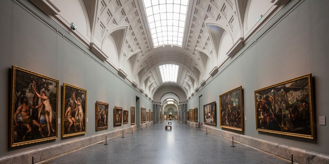 View of an empty gallery at El Prado Museum in Madrid, Spain, Thursday, March 12, 2020. The spread of the new coronavirus continues disrupting normal life in parts of Spain, and it's also affecting sports, cultural and all sorts of leisure events after the government imposed a ban on gatherings of more than 1,000 people and to cut to a third the maximum audience of all venues holding indoor sports or cultural events. (AP Photo/Bernat Armangue)