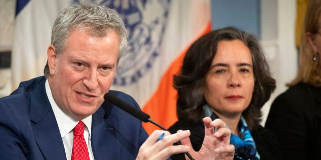 In this Wednesday, Feb. 26, 2020, file photo, Mayor Bill de Blasio, left, with Dr. Oxiris Barbot, commissioner of the New York City Department of Health and Mental Hygiene, reports on the city's preparedness for the potential spread of the coronavirus in New York.