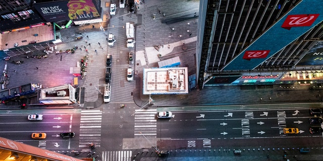 An empty Times Square is seen on the street following the outbreak of coronavirus disease (COVID-19), in New York City, U.S., March 18, 2020.