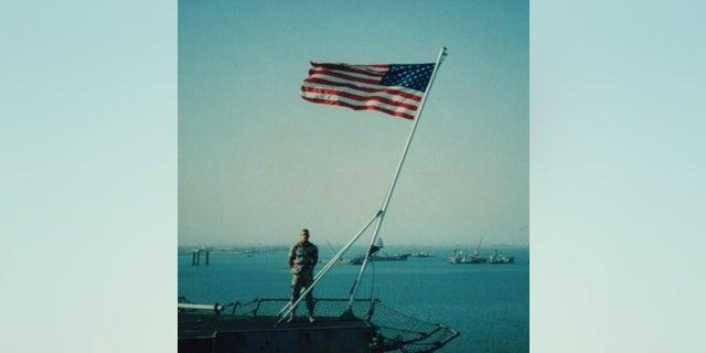 Marine David Price and the American flag (Facebook/David Price)