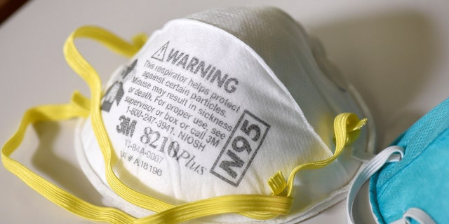 An official in Louisiana has been arrested for stealing several boxes of N95 respirator masks (Reuters)