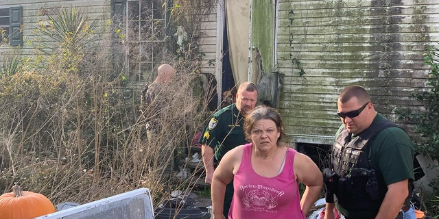 Cherly Grau Articas, 53, was arrested along with William Richard Grau, 78, after 118 dogs were rescued from their property in deplorable conditions.