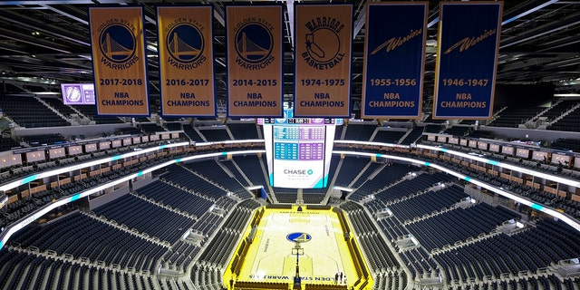 The Golden State Warriors championship banners hang above the seating and basketball court at the Chase Center in San Francisco. The NBA suspended the season Wednesday amid coronavirus fears.